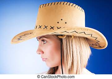 Young girl wearing cowboy hat in the studio