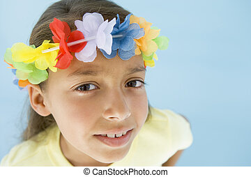 Young girl wearing garland on head