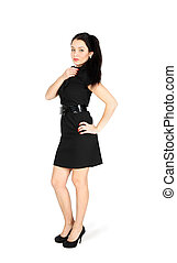 Young girl wearing short black dress stands