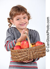 Young girl with a basket of apples