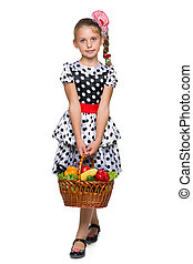 Young girl with a basket of vegetables
