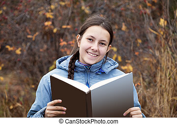 Young girl with a book