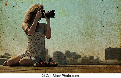 young girl with a camera