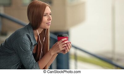 Young girl with a cup of coffee.