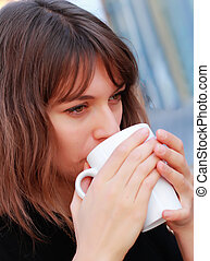 young girl with a cup of coffee