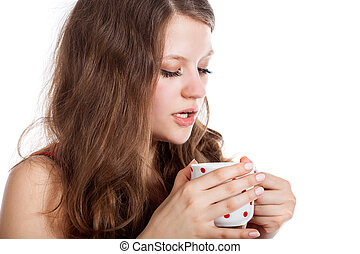 Young girl with a cup of tea in her hands