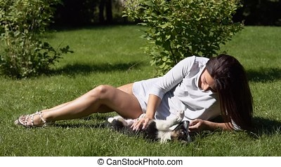 Young girl with a dog in the park on the grass.slow motion.