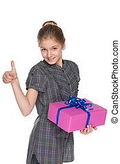 Young girl with a gift box holds her thumb up
