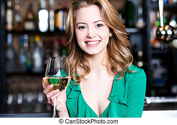 young girl with a glass of champagne attractive young girl enjoying champagne in a pub stock photos csp18157635