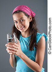 Young girl with a glass of water, concept of healthy lifestyle