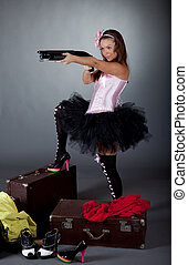 Young girl with a gun