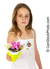 Young girl with a little plant for mothers day