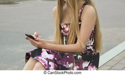 Young girl with a mobile phone outdoors