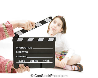 girl with a movie clapper - young girl with a movie clapper...