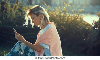 Young girl with a phone outdoors