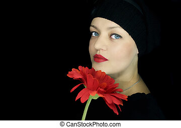 young girl with a red flower