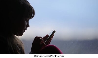 Young girl with a smartphone