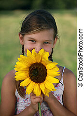 Young girl with a sunflower