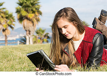 Young Girl with a tablet - Young teenager accessed online ...