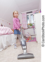 Young Girl with a vacuum cleaner