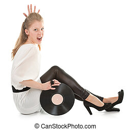 young girl with a vinyl record