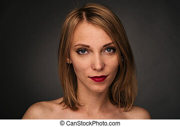 Young girl with acne. Photo of ugly girl with problem skin on dark background. Skin care concept