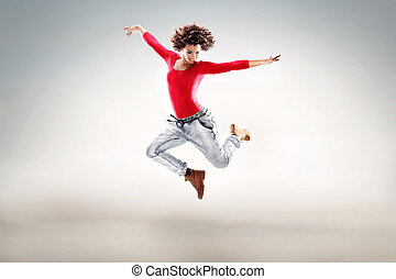Young girl with afro dancing.
