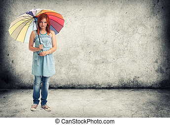 young girl with an umbrella