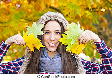 young girl with autumn leaves