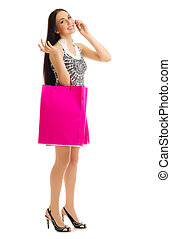 Young girl with bags talking by mobile phone