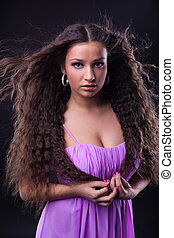 young girl with beauty long hair look at you
