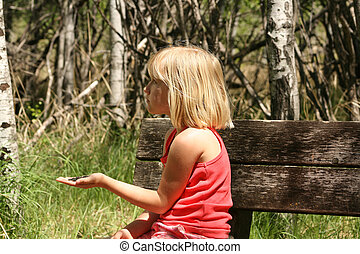 Young Girl With Bird Feed