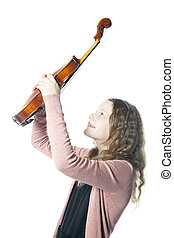 young girl with blond curly hair holds violin up in studio