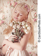 Young girl with bouquet from roses