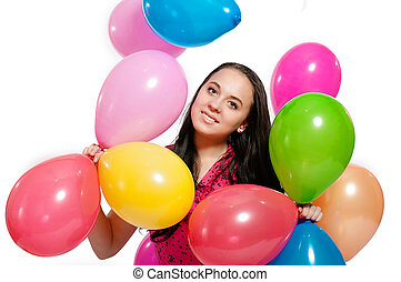 Young girl with bright balloons