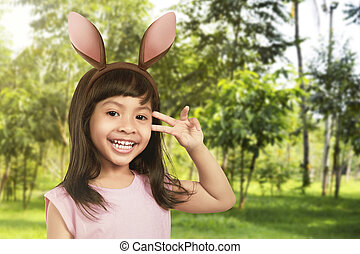 Young girl with bunny ears