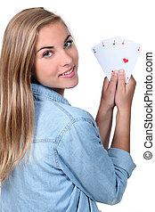 young girl with cards