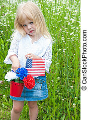 young girl with carnations and flag