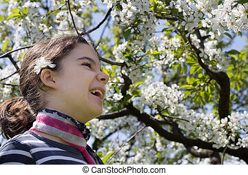 young girl with cherry blossom