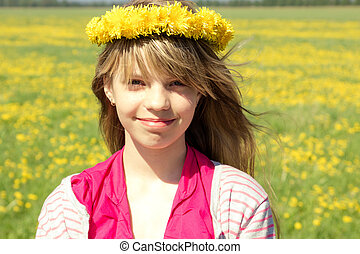 young girl with dandelion wreath