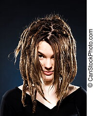 young girl with dreadlocks - studio shot portraits of a...