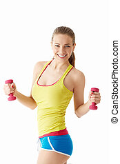 Young girl with dumbbells