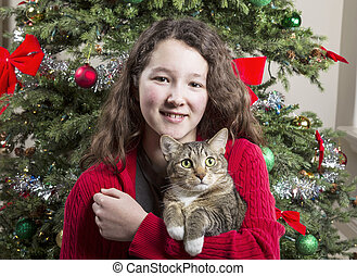 Young Girl with Family Pet during Holidays