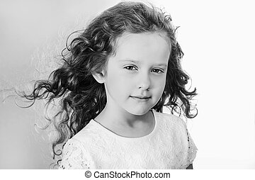 Young girl with flying hair. Black and white portrait.