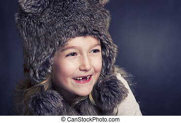 Young girl with fur winter ha