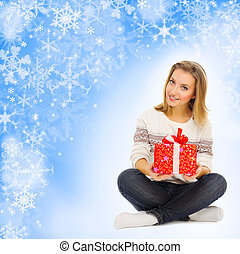 Young girl with gift box on winter background
