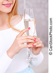Young girl with glass of champagne
