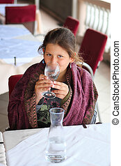 Young girl with glass of water