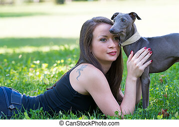 Young girl  with greyhound