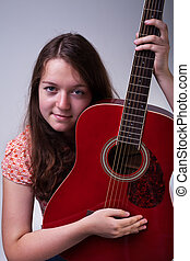 Young girl with guitar portrait